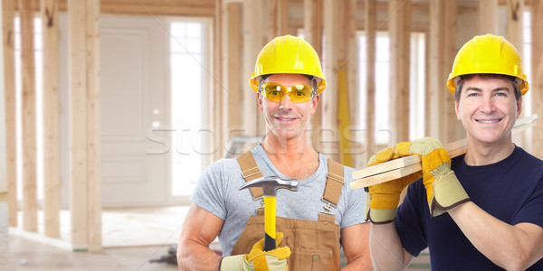 Handyman with a hammer. House renovation. Stock photo © Kurhan
