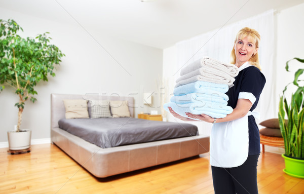 Maid woman with towels. Stock photo © Kurhan