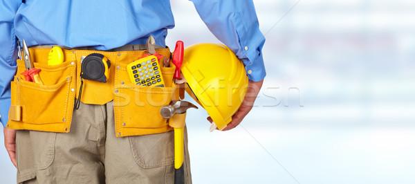 Construction worker with a tool belt. Stock photo © Kurhan