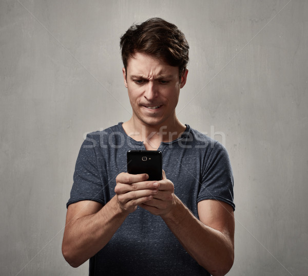Angry man with cell phone. Stock photo © Kurhan