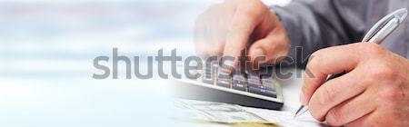 Accountant hands with calculator Stock photo © Kurhan