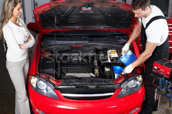 Auto mechanic and woman in auto repair shop. Stock photo © Kurhan