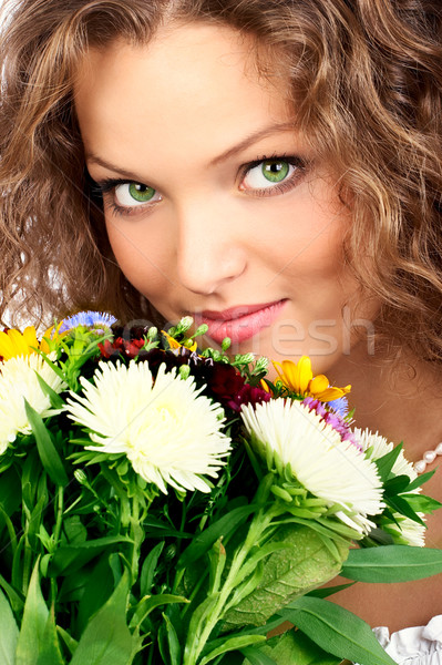 Happy young smiling woman with bunch of flowers Stock photo © Kurhan