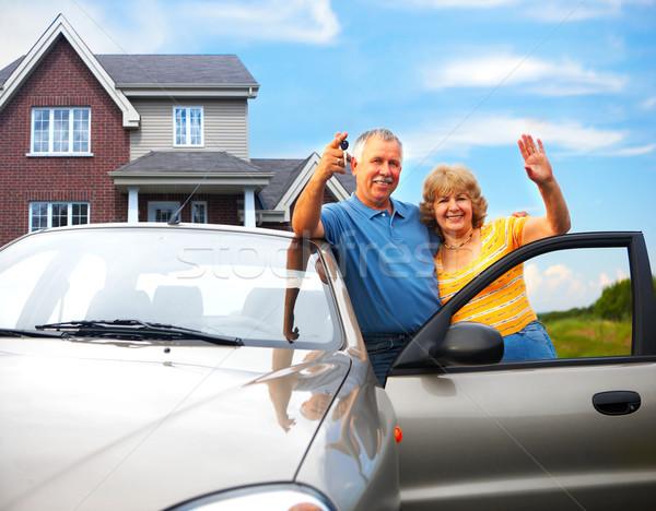 Stock photo: Elderly couple near their home