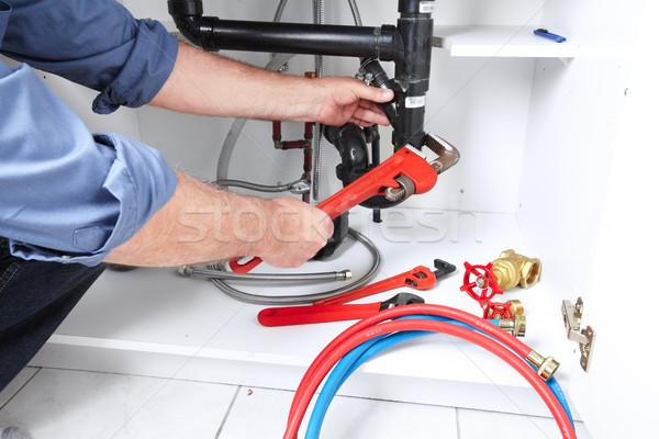 Photo stock: Mains · plombier · clé · professionnels · maison · fond