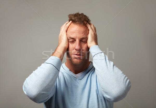 Depressie depressief man hoofdpijn grijs muur Stockfoto © Kurhan