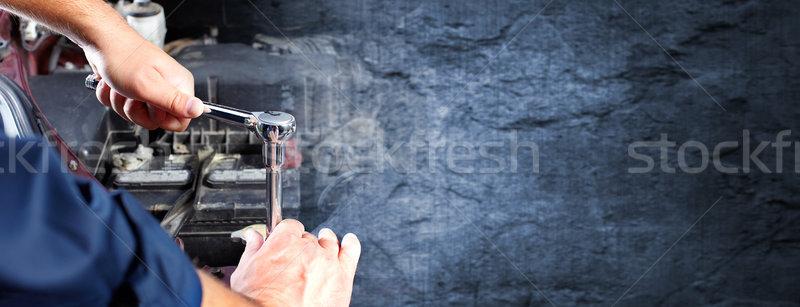Hands of car mechanic in auto repair service. Stock photo © Kurhan