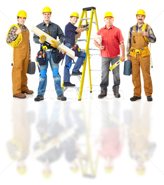 Stock photo: Industrial workers group.