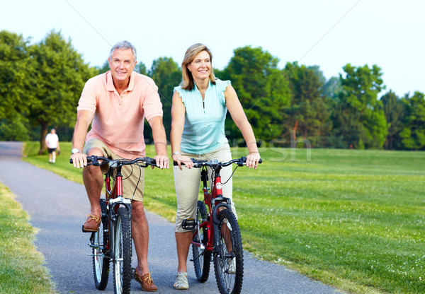 Stock photo: Senior couple cycling.