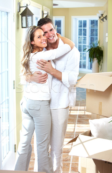 Stock photo: Happy couple moving in a new house.