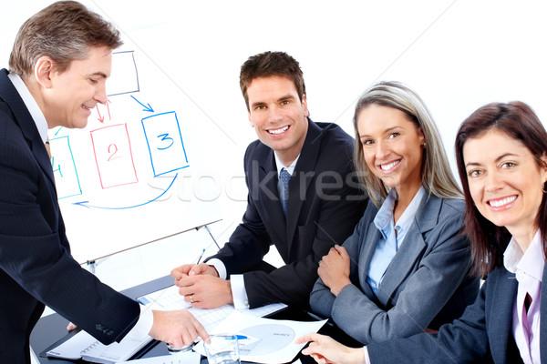 Stock fotó: üzletemberek · csapat · mosolyog · dolgozik · iroda · boldog