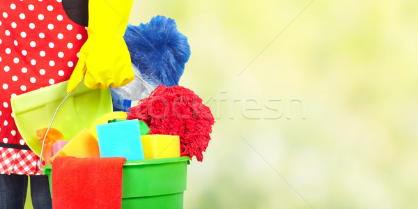 Maid hands with cleaning tools. Stock photo © Kurhan