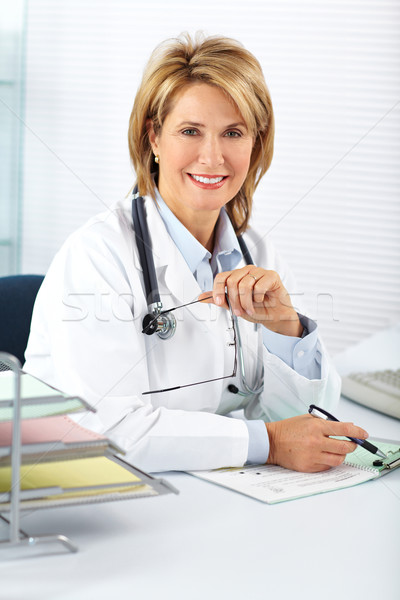 Stock photo: Mature doctor woman in a clinical office.