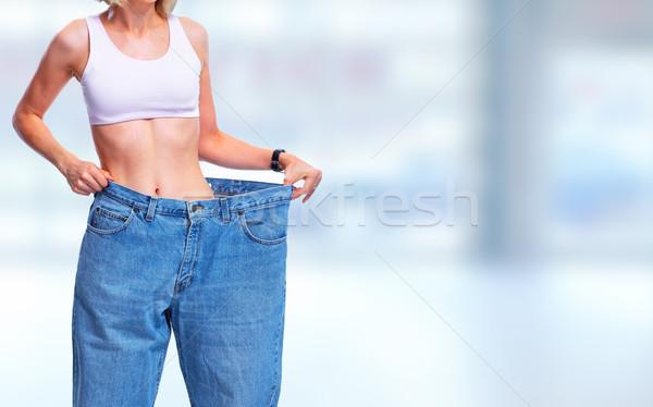 Nő visel nagy nadrág has kék Stock fotó © Kurhan