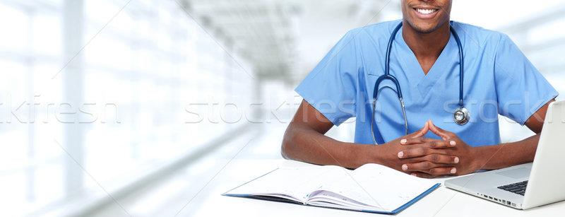 Hands of medical doctor man. Stock photo © Kurhan
