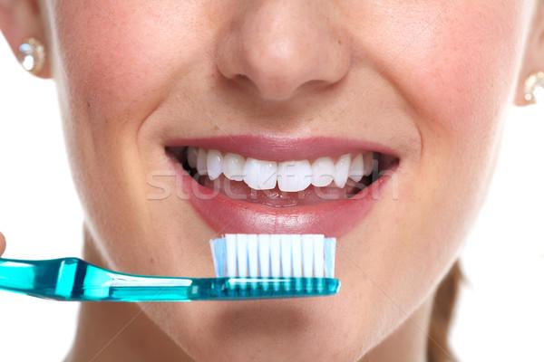 Young woman brushing her teeth. Stock photo © Kurhan
