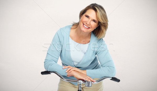 Beautiful elderly woman with bicycle. Stock photo © Kurhan