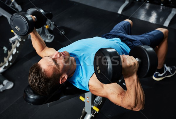 Gym bench press workout Stock photo © Kurhan