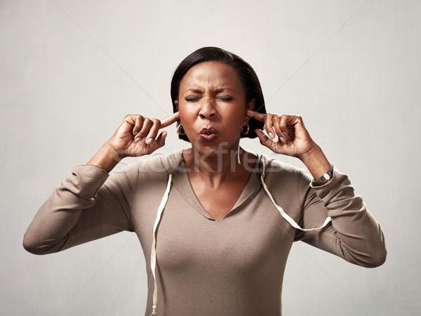 Afroamerikai nő afroamerikai nő ujjak fülek fekete Stock fotó © Kurhan