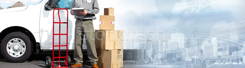 Postman with parcel box. Stock photo © Kurhan