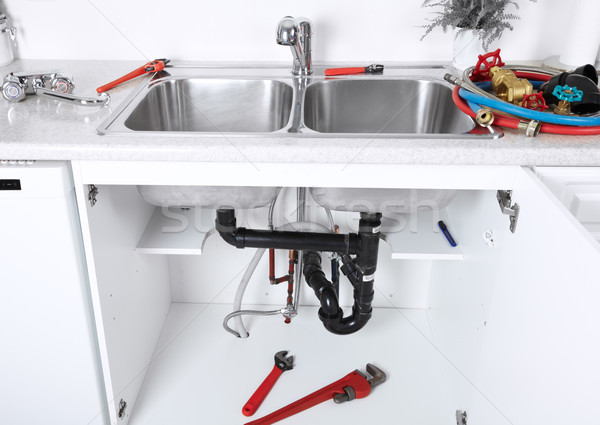 Stock photo: Kitchen sink pipes and drain. Plumbing.
