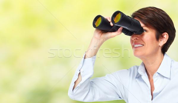 Business woman with binoculars. Stock photo © Kurhan