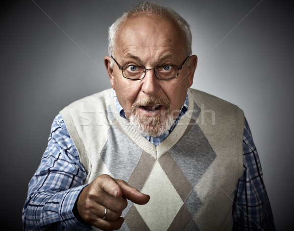 Old man pointing to the camera. Stock photo © Kurhan
