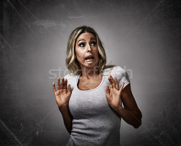 Scared afraid young woman fear. Stock photo © Kurhan