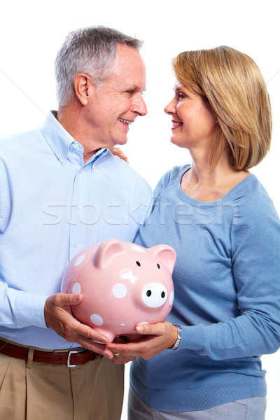 Stock photo: Couple with piggy bank.
