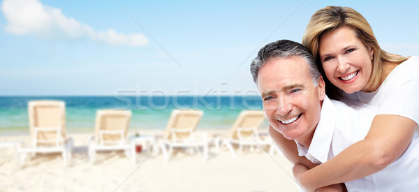 Happy senior couple on a tropical beach. Stock photo © Kurhan
