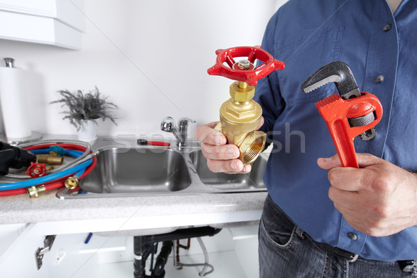 Plumber with a wrench. Stock photo © Kurhan