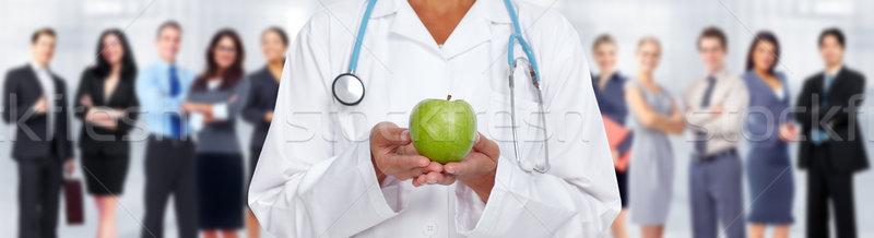 Doctor woman hands with apple. Stock photo © Kurhan