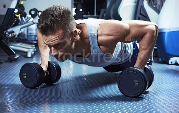 push-up with dumbbells Stock photo © Kurhan