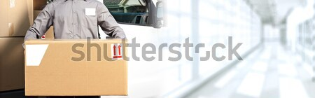 Delivery postman hands with a box Stock photo © Kurhan
