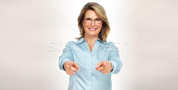 Donna d'affari maturo sorridere grigio business sfondo Foto d'archivio © Kurhan