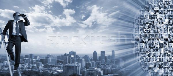 Empresário binóculo espionagem concorrentes escritório homem Foto stock © Kurhan