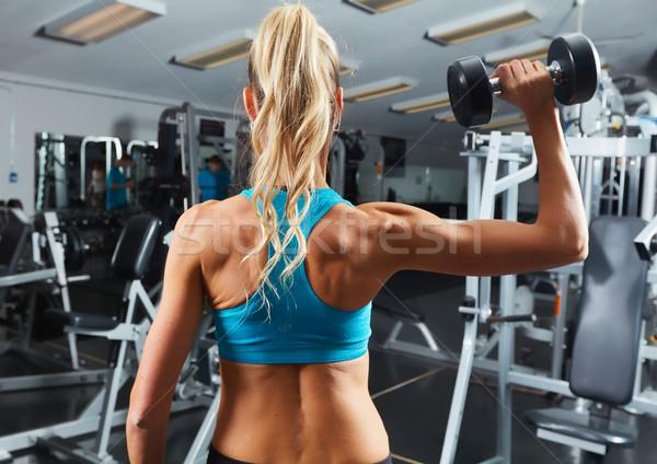 Dumbbell workout Stock photo © Kurhan