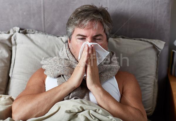 Sick man in bed Stock photo © Kurhan