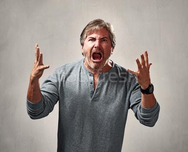 Agresif adam deli portre gri karanlık Stok fotoğraf © Kurhan
