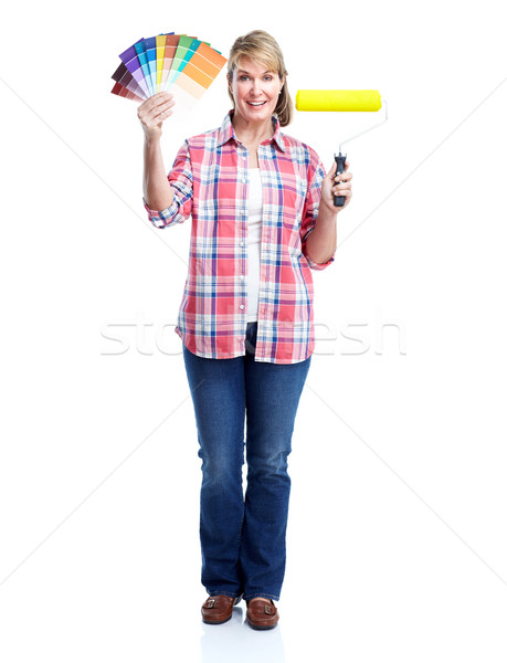 Senior woman doing renowation at home. Painter. Stock photo © Kurhan