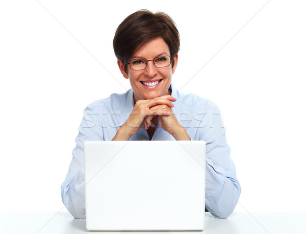 Business woman working with laptop. Stock photo © Kurhan