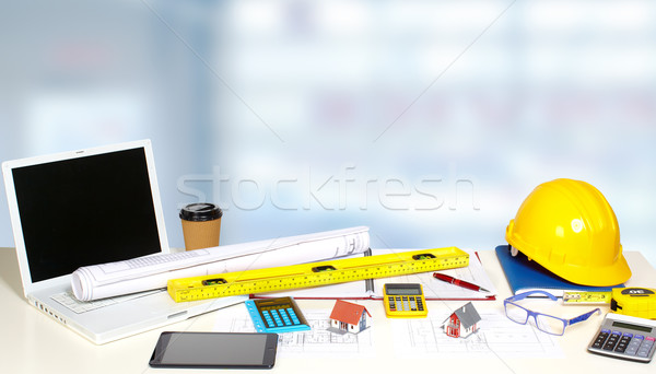 Stock photo: Little house and calculator on the table.