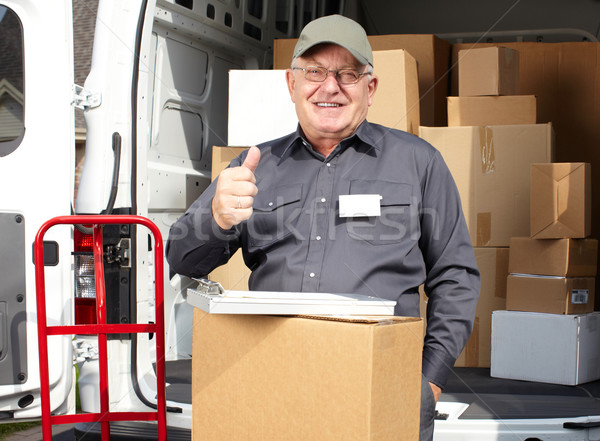 Senior delivery man with parcel near truck. Stock photo © Kurhan