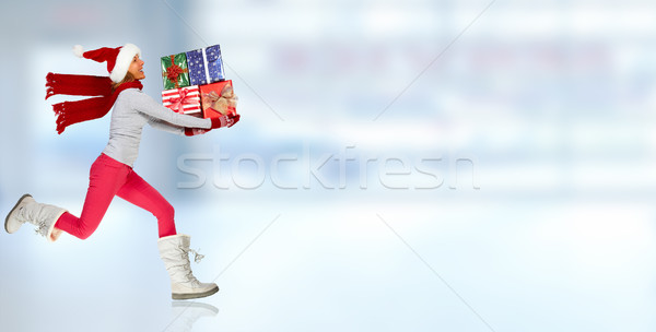 Happy running woman with Xmas gifts. Stock photo © Kurhan