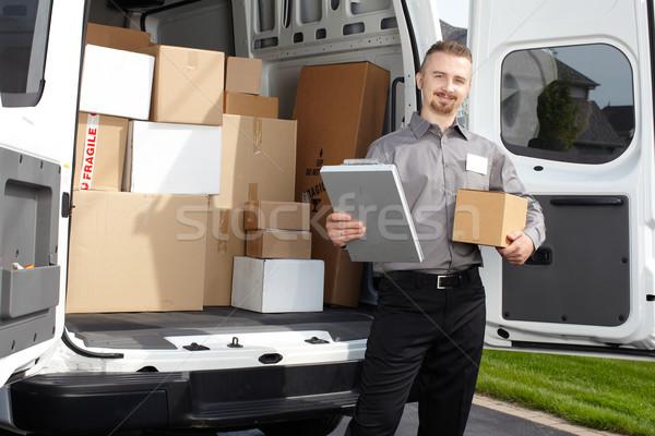 Jungen Briefträger Paket Lieferwagen Versandkosten Service Stock foto © Kurhan