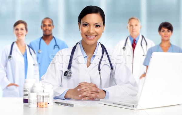 Asian Doctor woman with pills. Stock photo © Kurhan