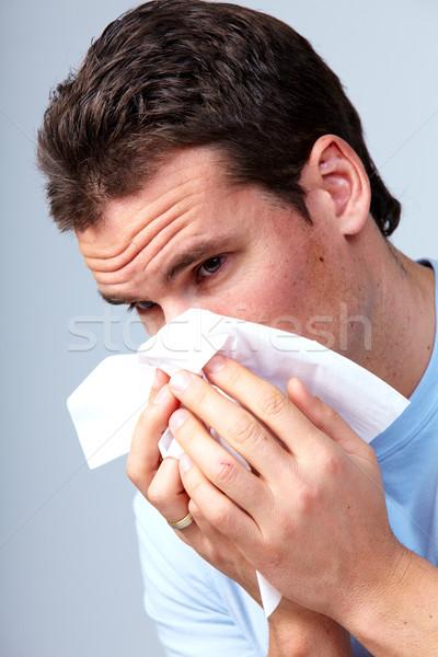 Sneezing man having cold. Stock photo © Kurhan