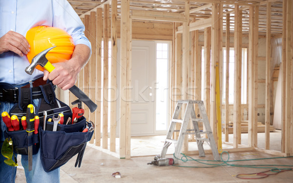 Handyman with a tool belt. Stock photo © Kurhan