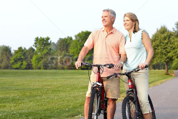 seniors couple biking Stock photo © Kurhan