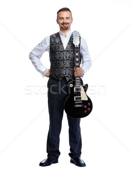 Młodych piosenkarka człowiek gitara odizolowany biały Zdjęcia stock © Kurhan